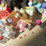 Spray paint cans on the street during the 2019 festival